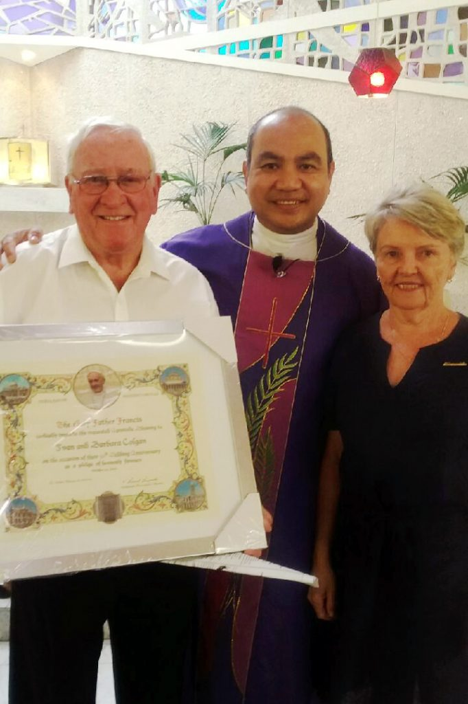 Floreat Wembley parishioners Ivan and Barbara Colgan last year recognised their 50th wedding anniversary with a particular honour, receiving a Papal Blessing which was presented to them by their Parish Priest Father Andrew Albis. Photo: Supplied