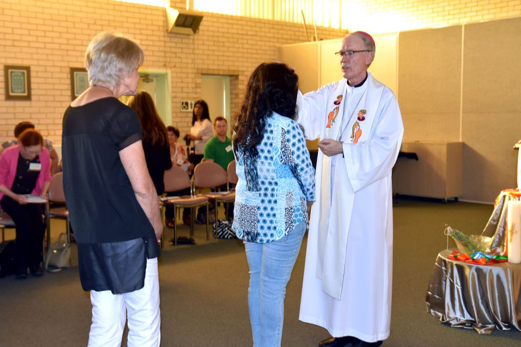 Personal Advocacy Service volunteers are missioned and blessed by Bishop Sproxton during the event in Morley. Photo: Caroline Smith