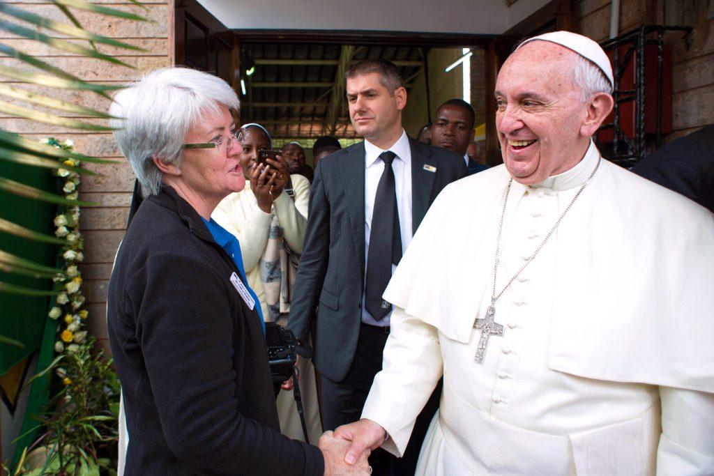Sr Kathy with Pope Francis on his trip to the slums in Nairobi, where the Holy Father was able to dialogue with locals and reiterated the 'moral duty incumbent on all of us' to accompany others in their struggles. Photo: Supplied