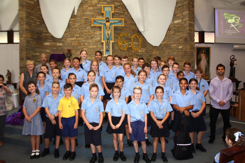 Matthew Gibney Catholic Primary Mini Vinnies with Dr Daniel Lombardi (right), Mr Robert Harding (President, St Vincent De Paul St Francis of Assisi, Maida Vale, left) and Assistant Principal, Mrs Karen Keddie. Photo: Supplied