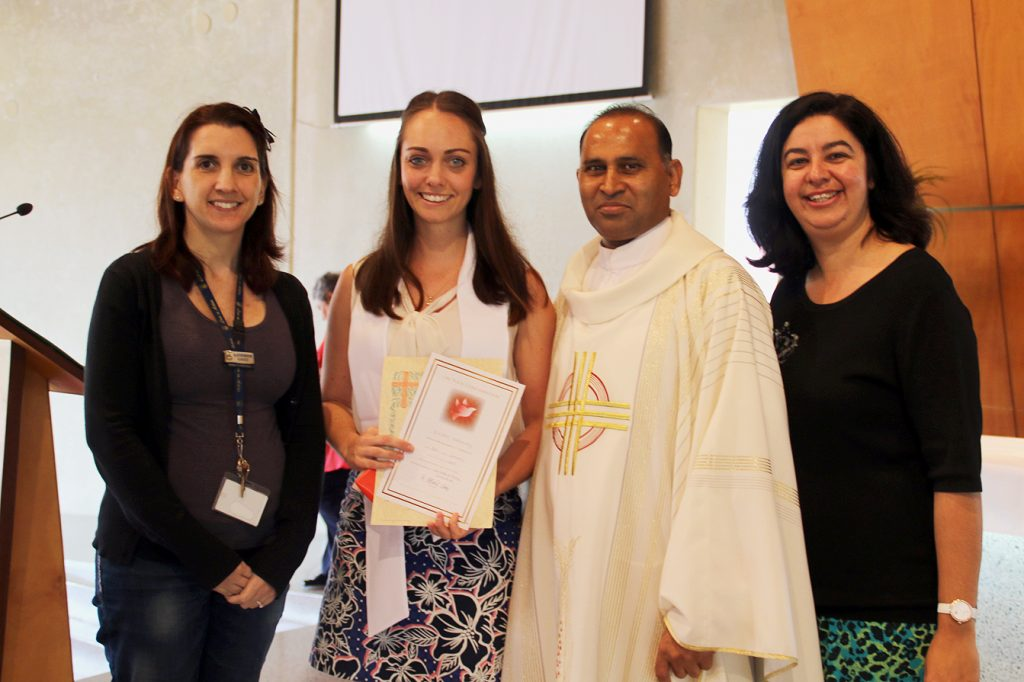 Left to right: Sponsor Katherine Gauci, Candidate Eleisha Hathaway, College Chaplain Fr Albert Saminedi and Director of Mission for Mercy College and Sponsor Melissa Cartner Photo: Supplied