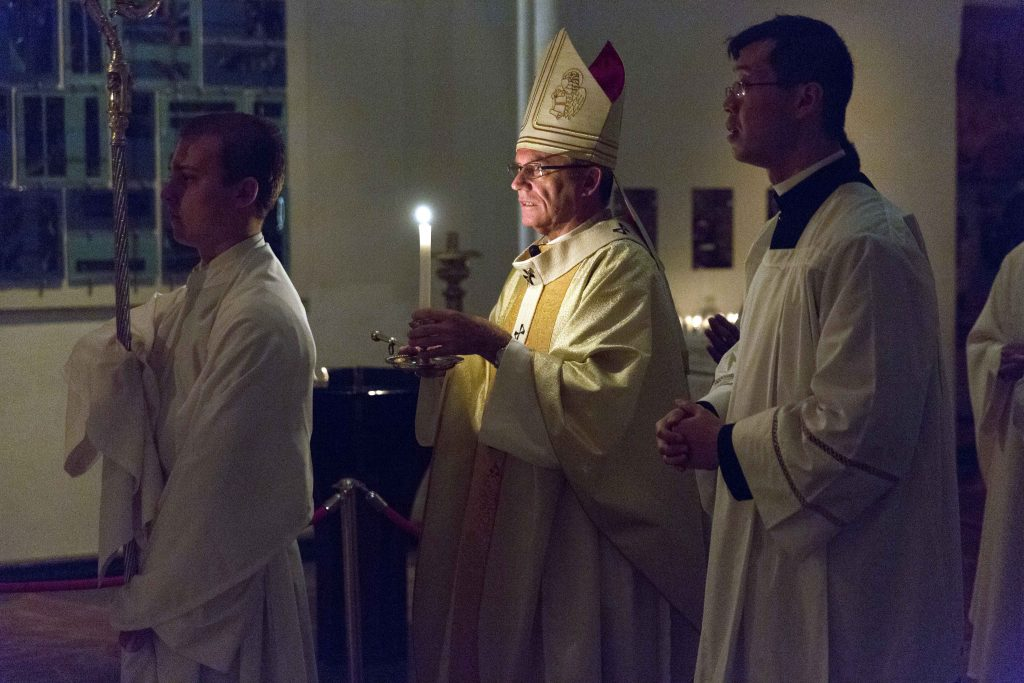 The record easter 2017 archbishop costelloe accept the gift of archbishop timothy costelloe holds a candle during the celebration of the easter vigil at marys cathedral negle Images
