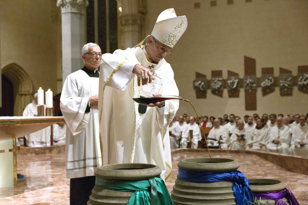 The Oil of Catechumens, Oil of the Sick and Oil of the Chrism were blessed by the Most Rev Archbishop Costelloe to be used by clergy in their Parishes throughout the year. Photo: Ron Tan