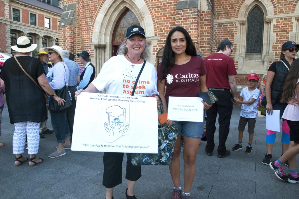 Carol Mitchell, Director of the Archdiocese of Perth's Justice, Ecology and Development Office (JEDO) with Caritas Australia WA/NT Justice Educator Anita Finneran at the annual Palm Sunday Walk for Refugees. Photo: Caroline Smith
