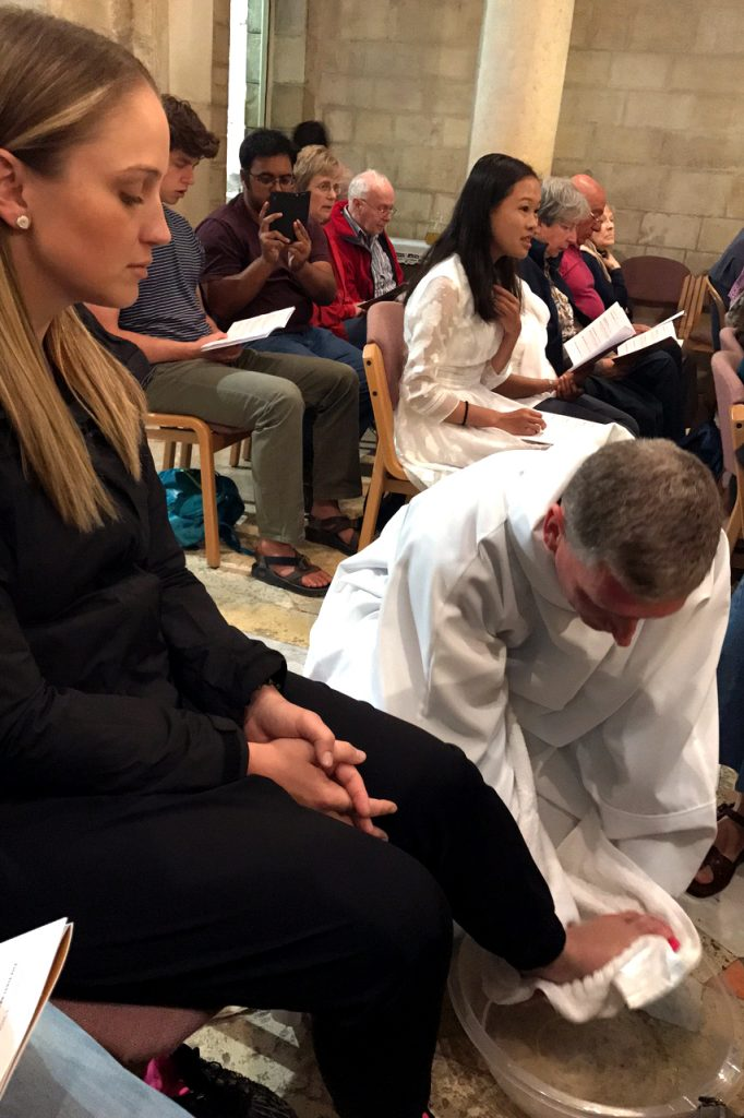 Tantur participant, Gemma Thomson, at the Washing of the Feet and Last Supper Mass at the Ecce Homo Convent in Jerusalem. Feet being washed by Tantur Ecumenical Institute Rector Fr Russ McDougall. Photo: Gemma Thompson