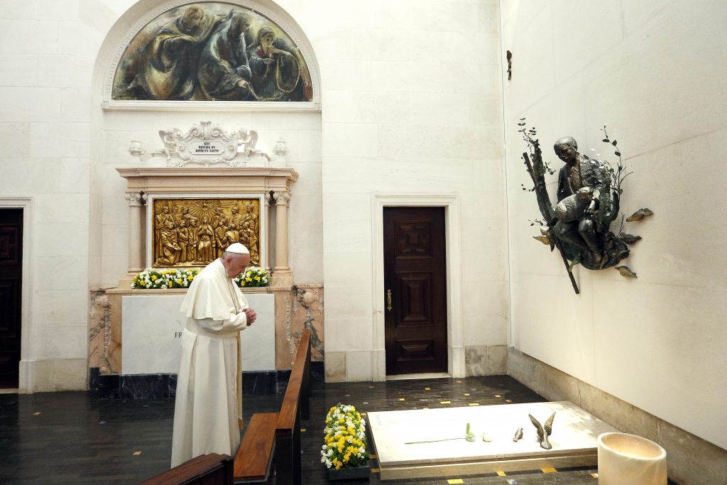 Pope Francis prays at the tomb of Fatima seer Francisco Marto before celebrating the canonisation Mass for him and his sister, Jacinta Marto, at the Shrine of Our Lady of Fatima in Portugal on the 13 May. The Mass marked the 100th anniversary of the Fatima Marian apparitions, which began on May 13, 1917. Photo: CNS/Paul Haring.
