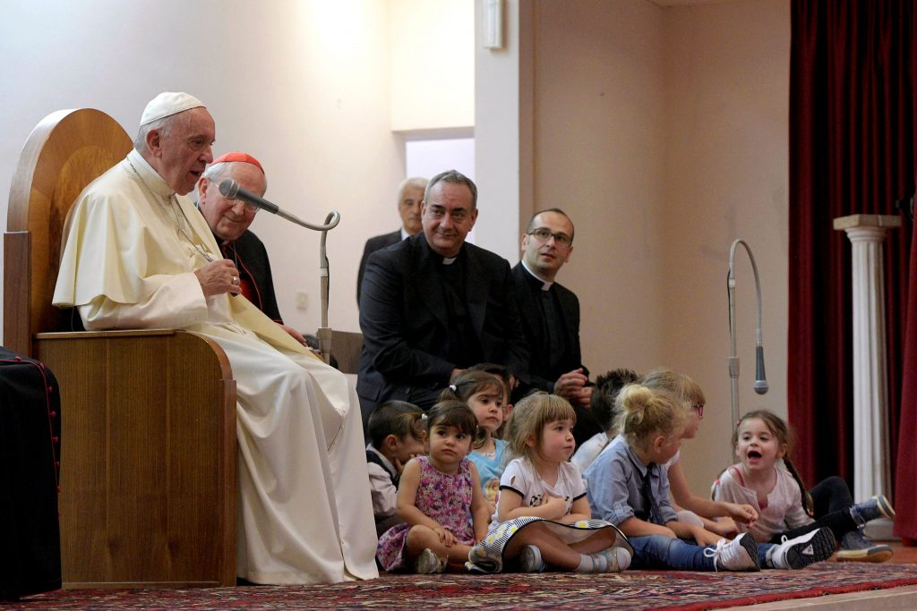 Children gather around Pope Francis as he speaks during his visit to the parish of San Pier Damiani on 21 May at Casal Bernocchi on the outskirts of Rome. Photo: CNS photo/L'Osservatore Romano.