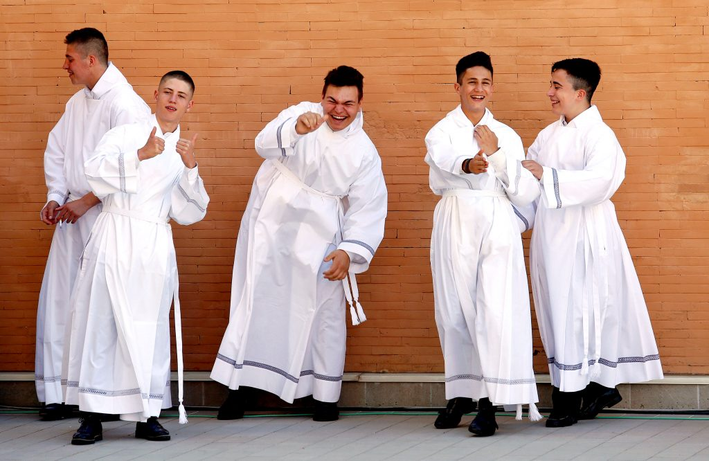 Altar servers are seen before Pope Francis arrives for a visit to the parish of San Pier Damiani May 21 at Casal Bernocchi on the outskirts of Rome. Photo: CNS/Remo Casilli, Reuters.