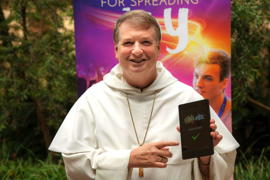 Sydney Archbishop Anthony Fisher registers for the 2017 Australian Catholic Youth Festival. Photo: Supplied.