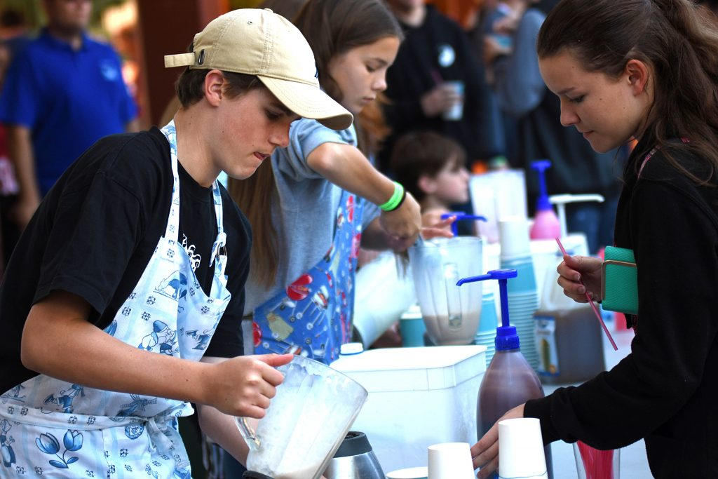Sixty-four Pastoral Care Groups within the college came together to raise money through participating in activities, along with the sale of food and drinks, with students volunteering their time and effort at stalls. Photo: Josh Low.