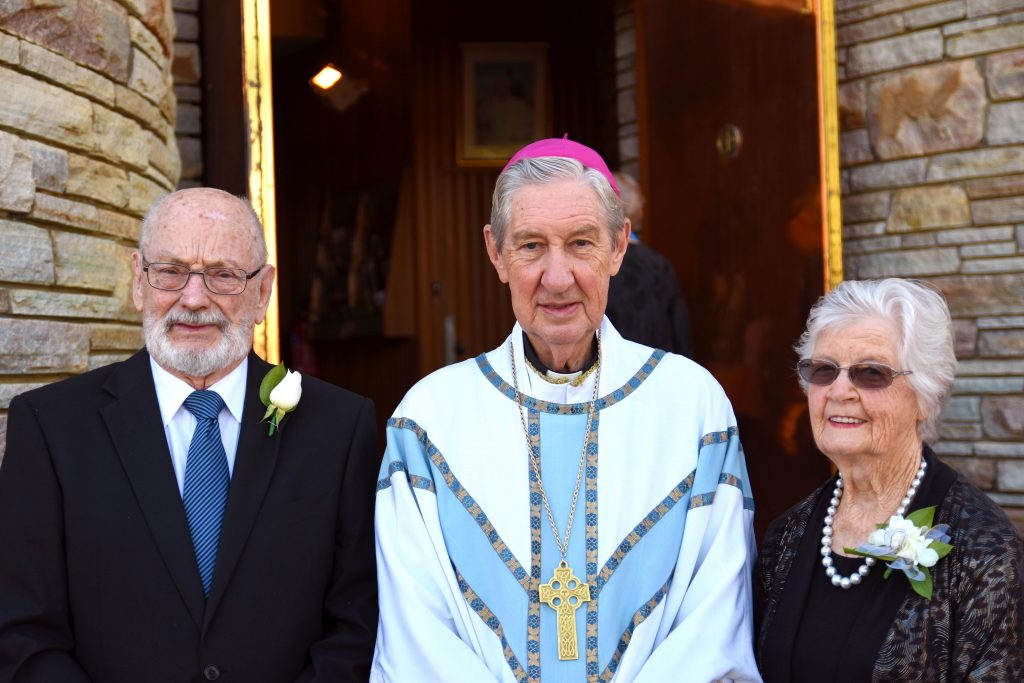 Mr and Mrs Peachey with Emeritus Archbishop Barry Hickey who celebrated their 60th anniversary Mass. Photo: Josh Low.