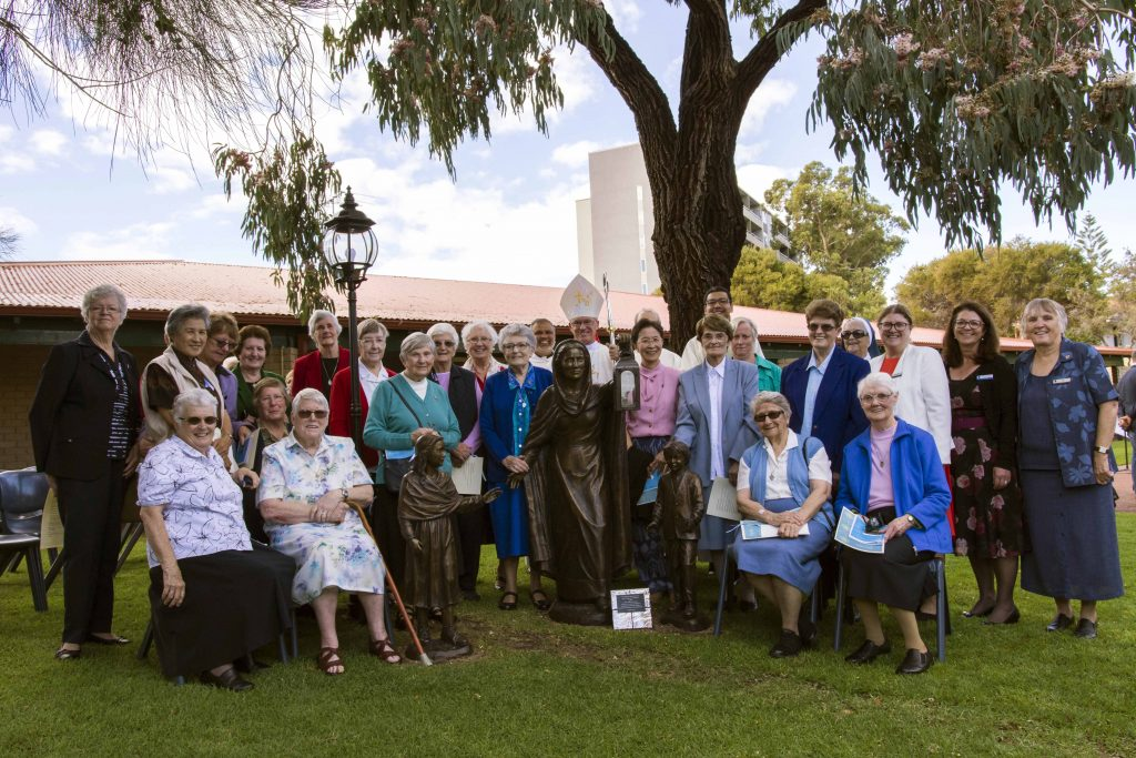 The sisters of the Presentation Order together with Archbishop Costelloe paying homage to the newly erected Nano Nagle statue in the Presentation Garden. Photo Natashya Fernandez.