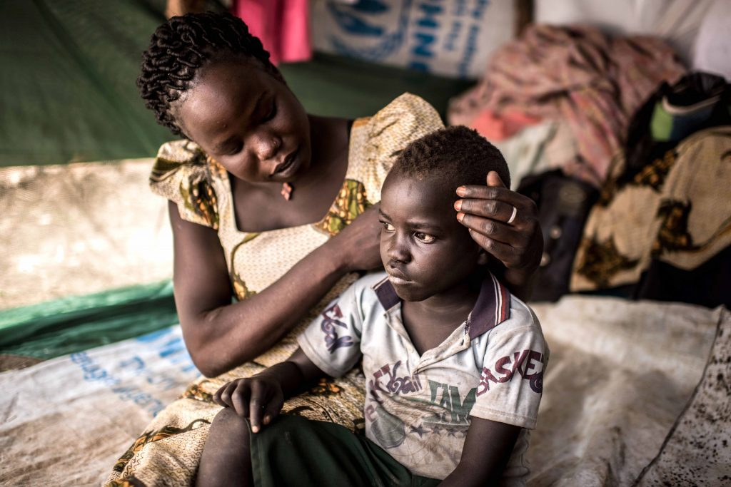 Viola Tabo and her son Charles in South Sudan's Loka village. Photo: Tommy Trenchard Caritas Internationalis.