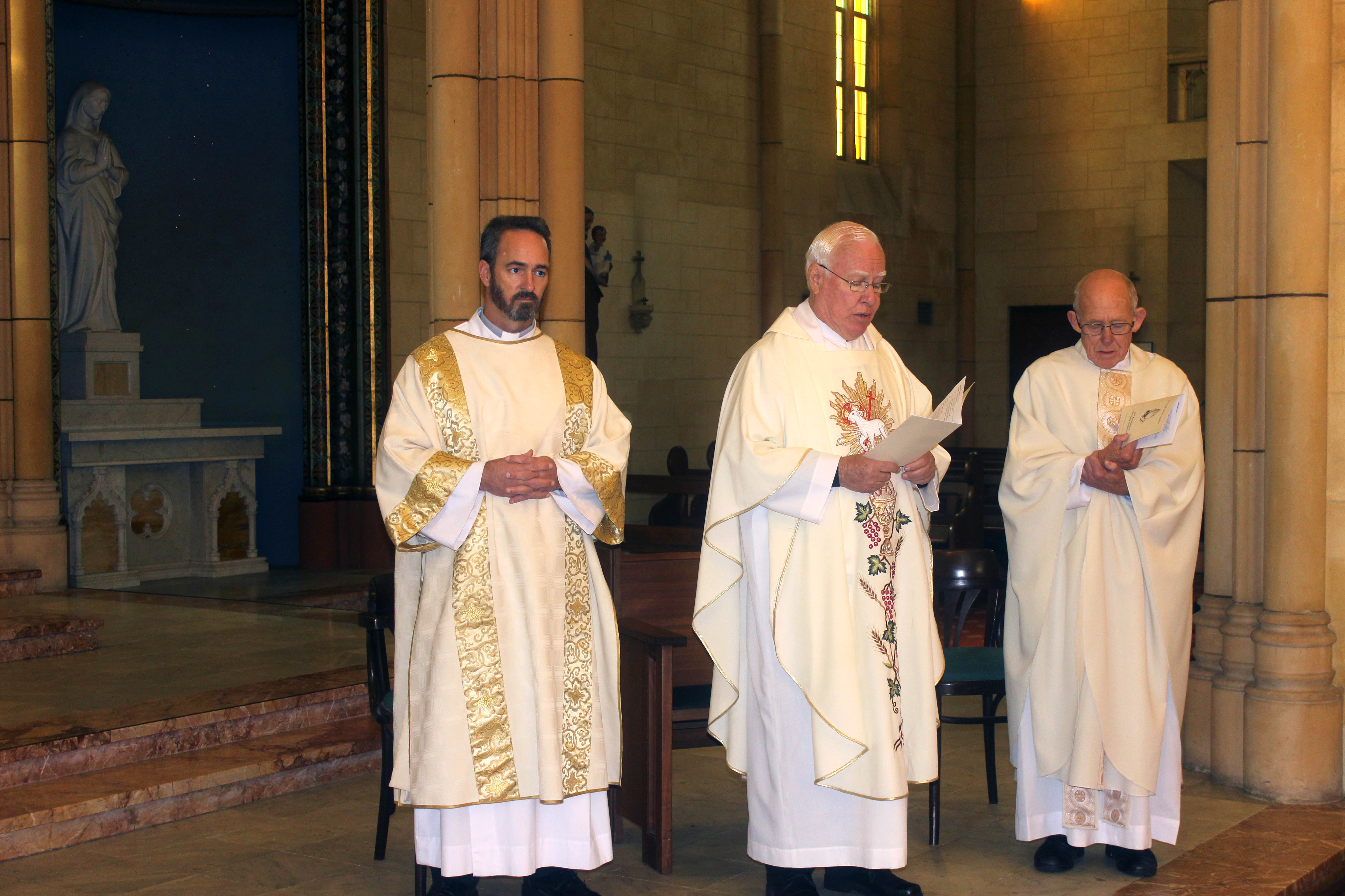 Fr Vincent Conroy with Fr Geoff Aldous and Deacon Aaron Peters at the anniversary Mass. Photo: Supplied.