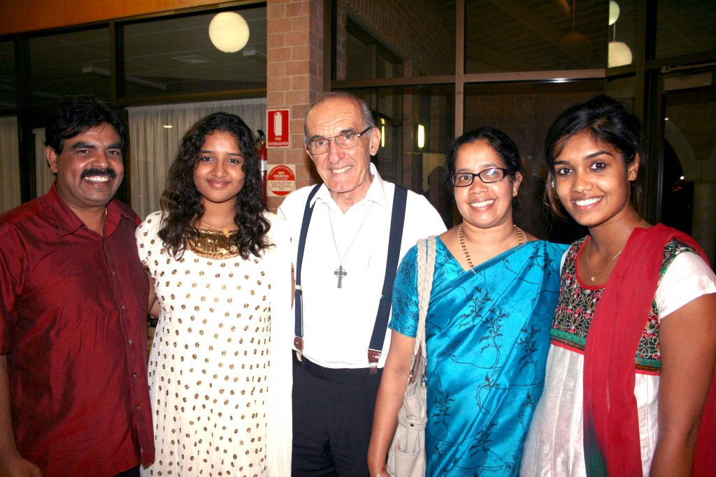 Bishop Justin Bianchini with parishioners on the celebration of Multicultural Night in 2013. Photo: Supplied.