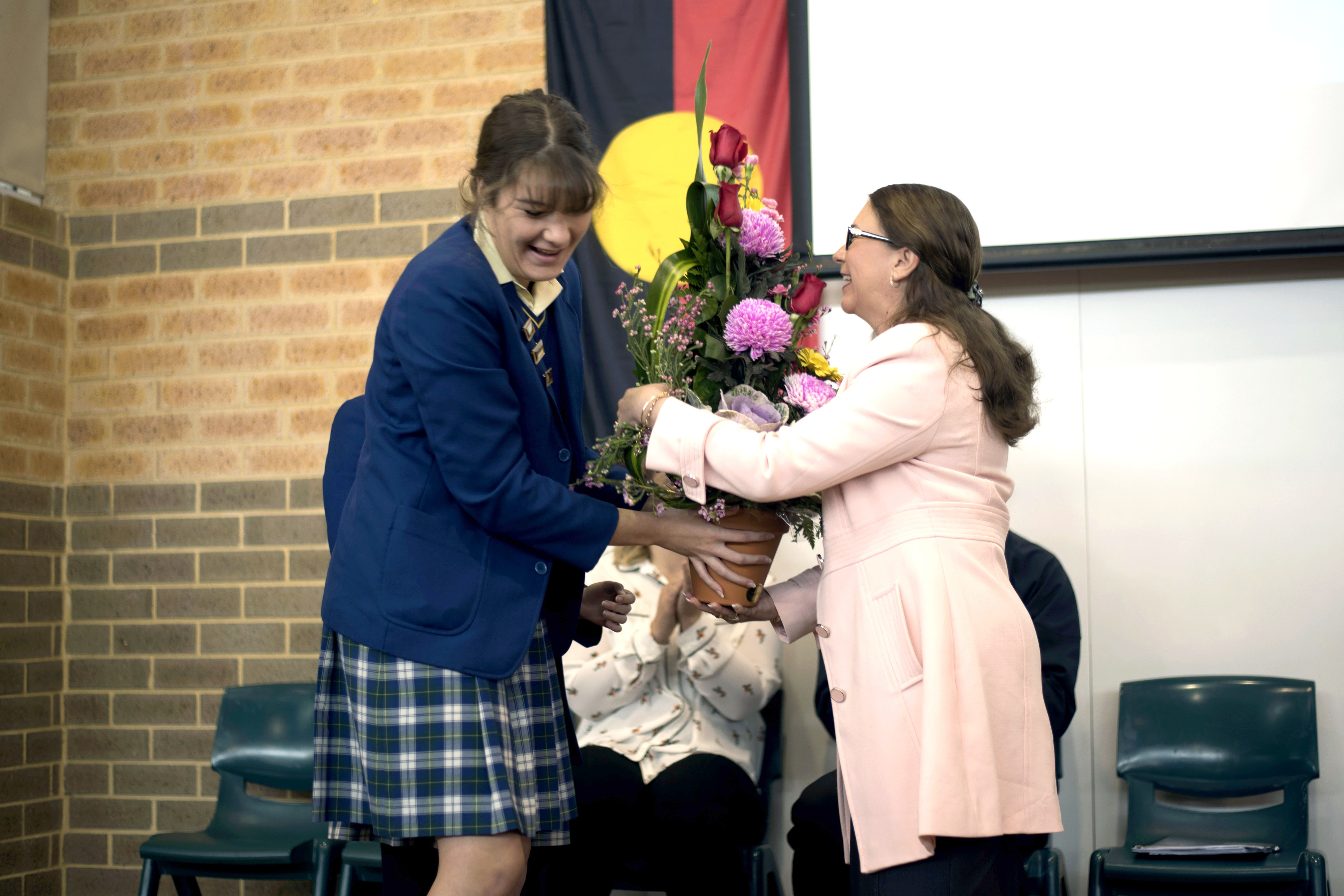 Mrs Morey was farewelled last month and is pictured receiving her farewell gift from Kilnacrott House Captain and Year 12 student Abbey Wheeler. Photo: Supplied.