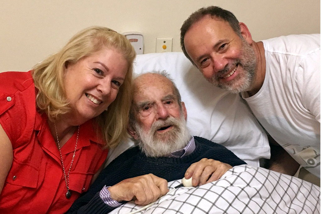Siblings Deborah Anderson and Mark Williams with Fr Rodney Williams on his 95th birthday in March 2017. Photo: Supplied.