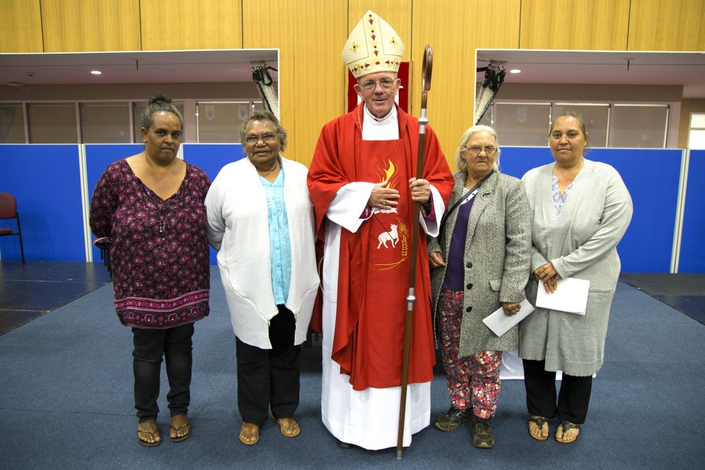 Newly ordained Bishop of Geraldton the Most Rev Michael Morrissey with local Aboriginal parishioners. Photo: Jamie O'Brien.