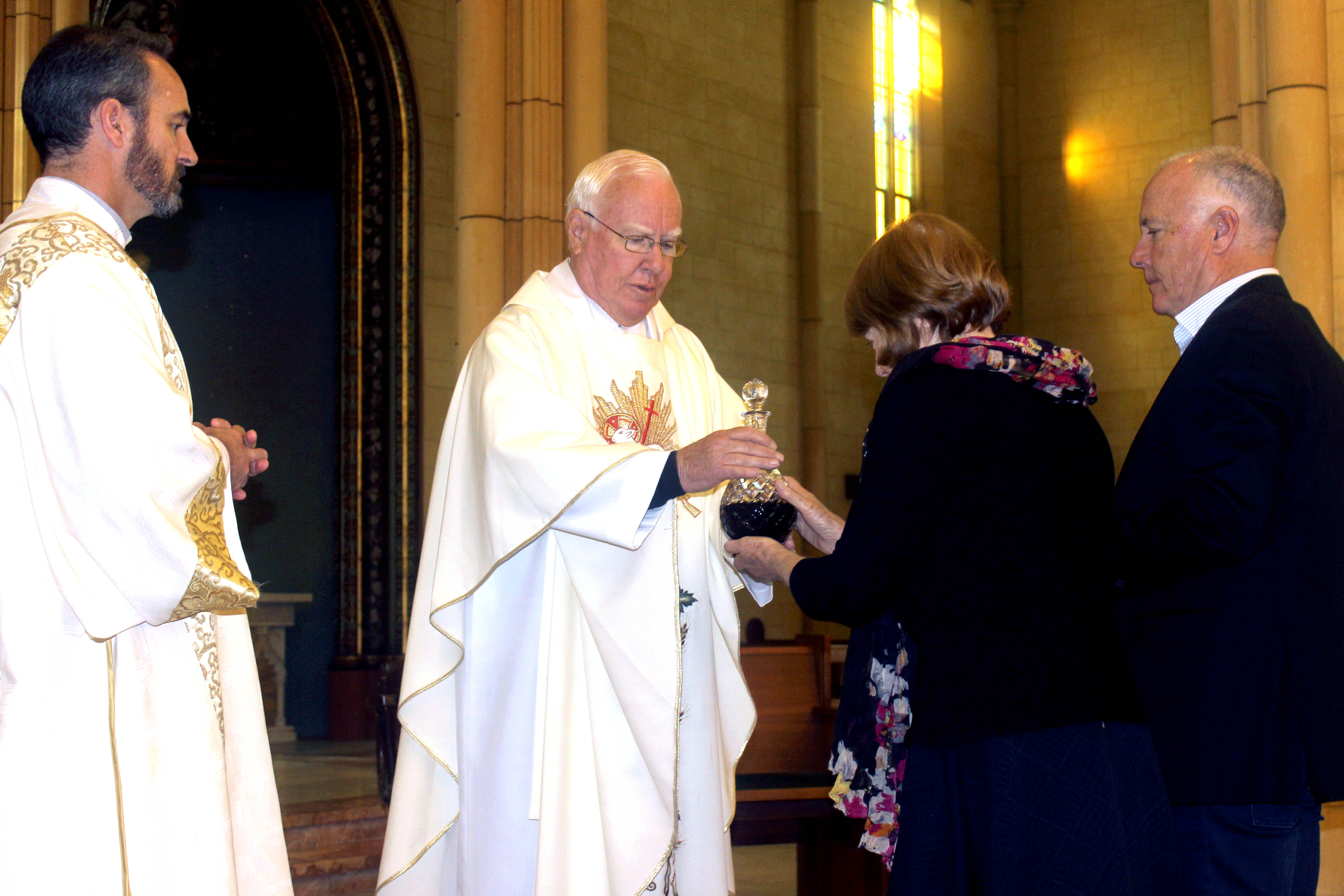 Fr Vincent Conroy with his sister Clare Evans and brother Peter Conroy bringing up the offertory gifts at his 50th anniversary Mass. Photo: Supplied.