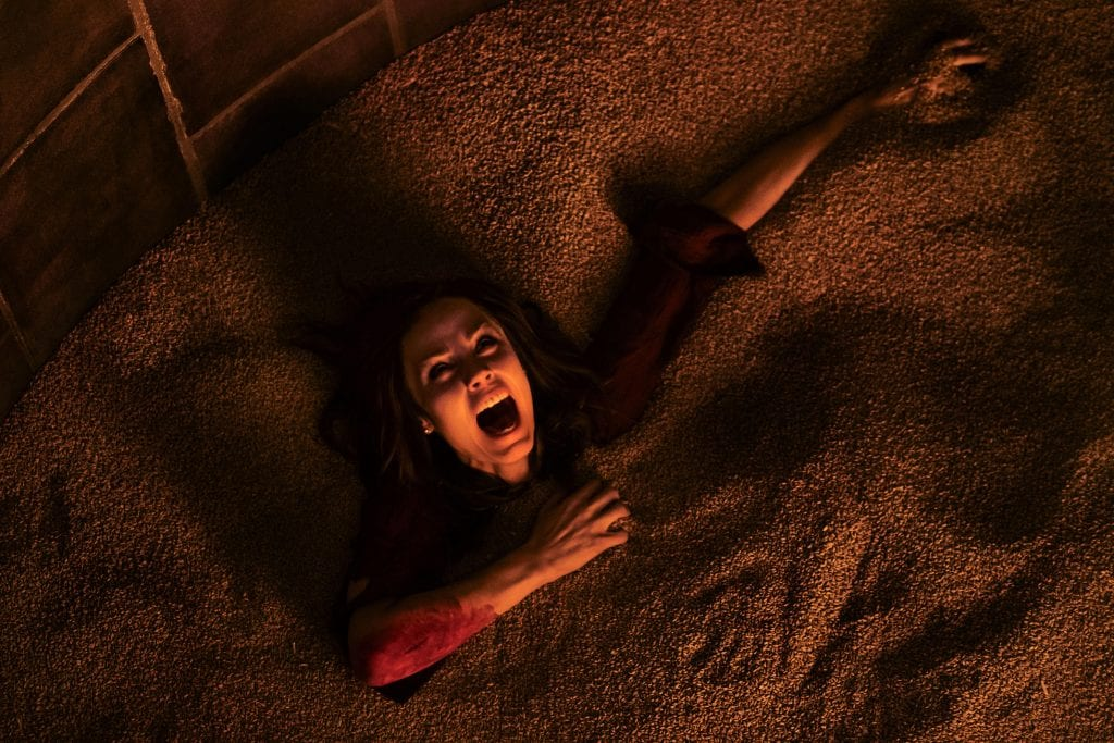Laura Vandervoort stars in a scene from the movie, Jigsaw. Photo: CNS/Lions Gate.