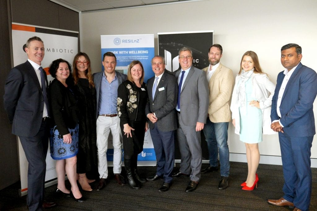 Members of the Access Wellbeing Services team at the launch of the ReSILnZ app (Left to Right) Rod West, Carolyn Padua, Coby Greer, Brendan Collins, Catherine Spini, Tony Pietropiccolo AM, Clive Elliott, Luca Lucioli, Valery and Ti-roo. Photo: Supplied.