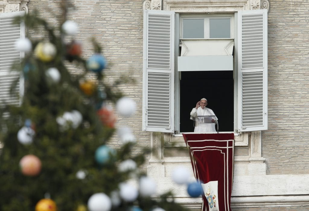 The Christmas tree is seen as Pope Francis leads the Angelus from the window of his studio overlooking St. Peter's Square at the Vatican Dec. 8, the feast of the Immaculate Conception. (CNS photo/Paul Haring) See POPE-IMMACULATE-CONCEPTION Dec. 8, 2017.