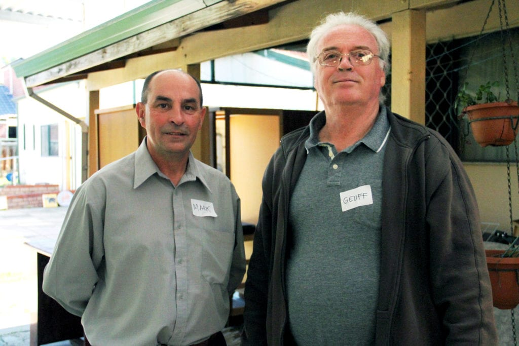 Fr Mark James with Geoff Scott (deaf) who teaches art at Emmanuel Centre. Photo: Theresia Titus.