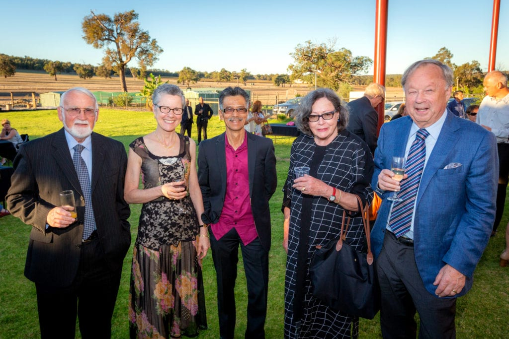 """Guests are seen posing for a photo before """"An evening of elegance"""". The event showcased an array of sacred and classical music from Bach, Vivaldi and Tchaikovsky. Photo: Michael Connelly."""