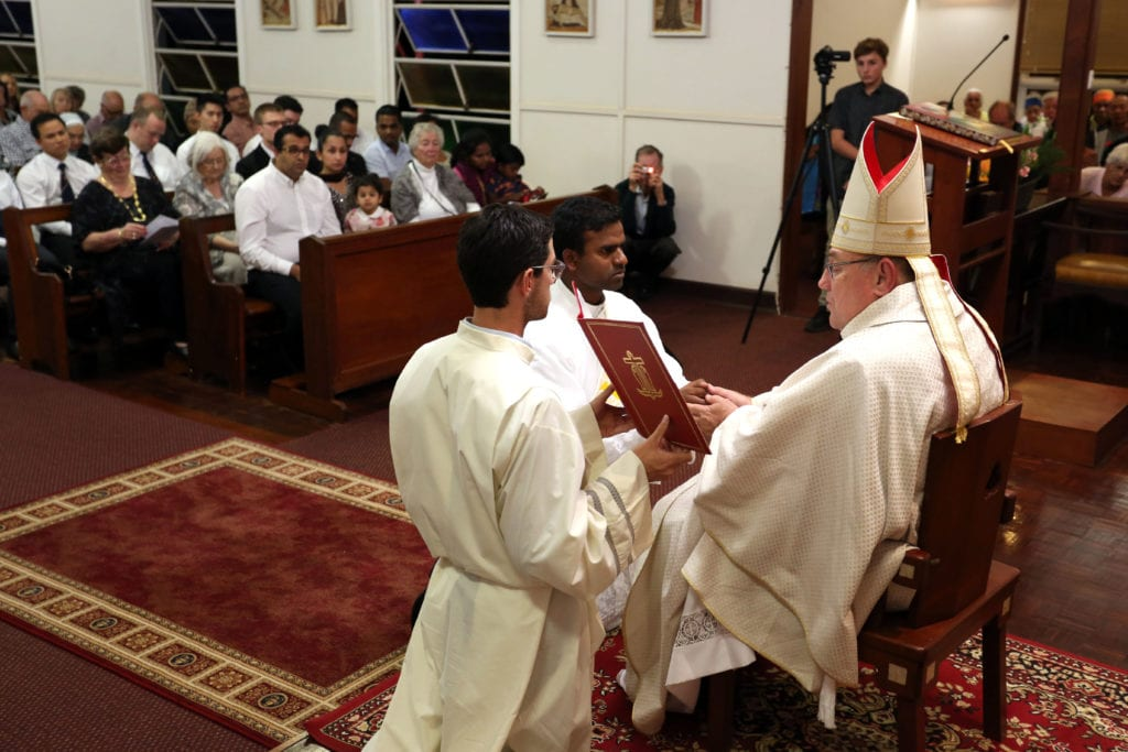 John Bosco make his vows before Broome Bishop Christopher Saunders on Saturday 23 June during his Ordination to the Priesthood at Our Lady Queen of Peace Cathedral. Photo: Supplied.