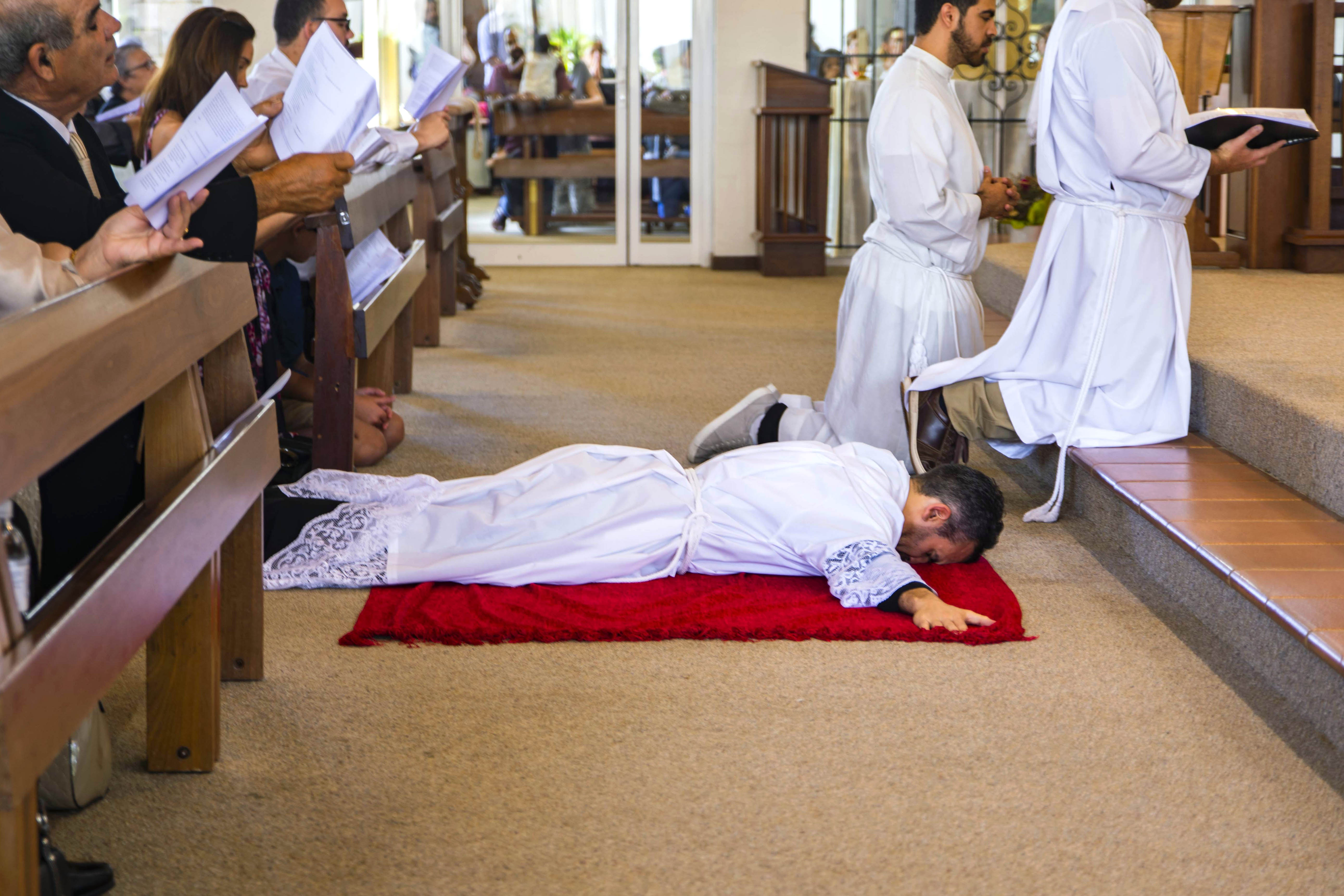 Br Chris de Sousa prostrates before the altar during his Ordination to the Diaconate on 3 November 2018 at St Jerome's Church, Spearwood. Photo: Matthew Lau.