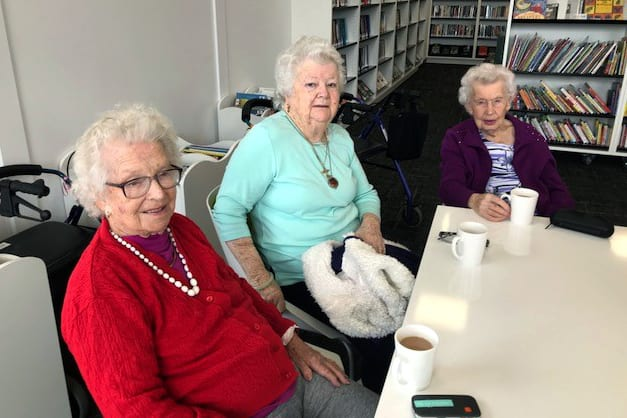 Mercy Place Mandurah residents Maisie Kilgallon, Beth Vine and Edith Edwards during morning tea. Photo: Supplied.