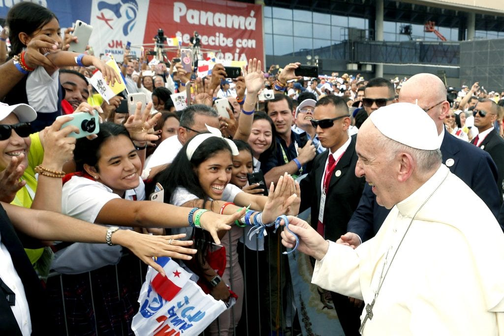 Pope Francis holds a bracelet given by a young person as he arrives at Tocumen International Airport in Panama City on 23 January 2019. Photo: CNS/Paul Haring.