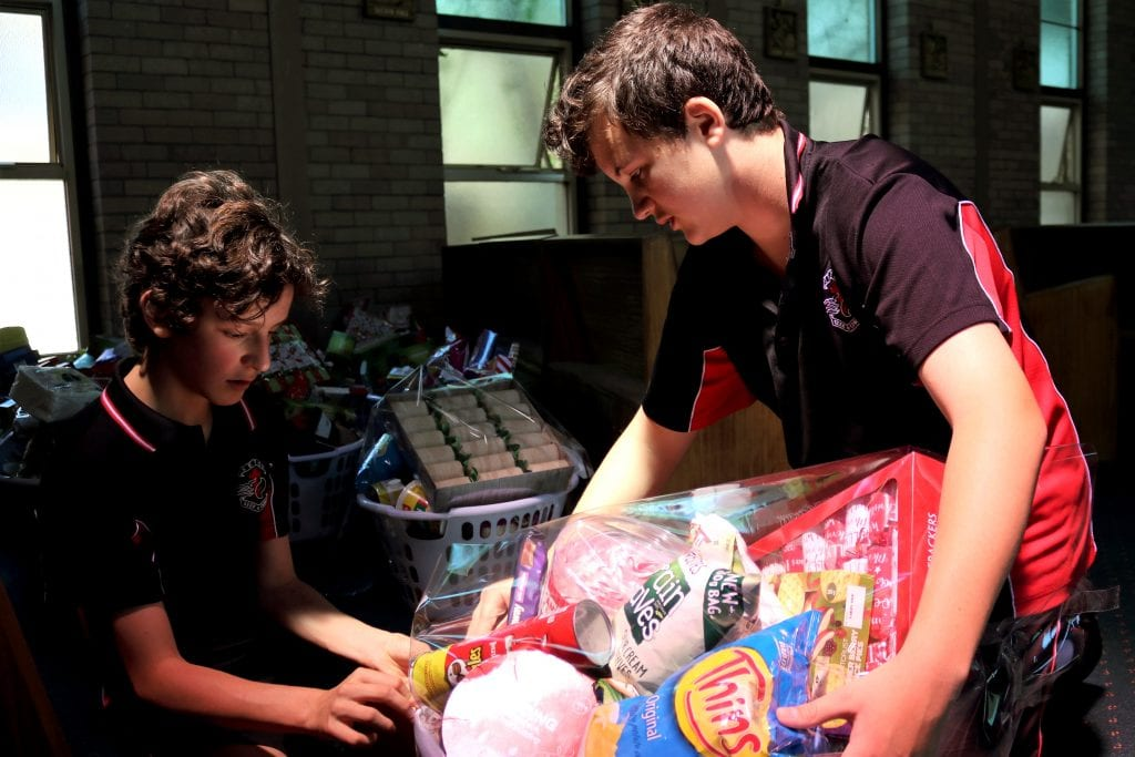 Seton Catholic College students assist with preparation of the hampers. Photo: Supplied