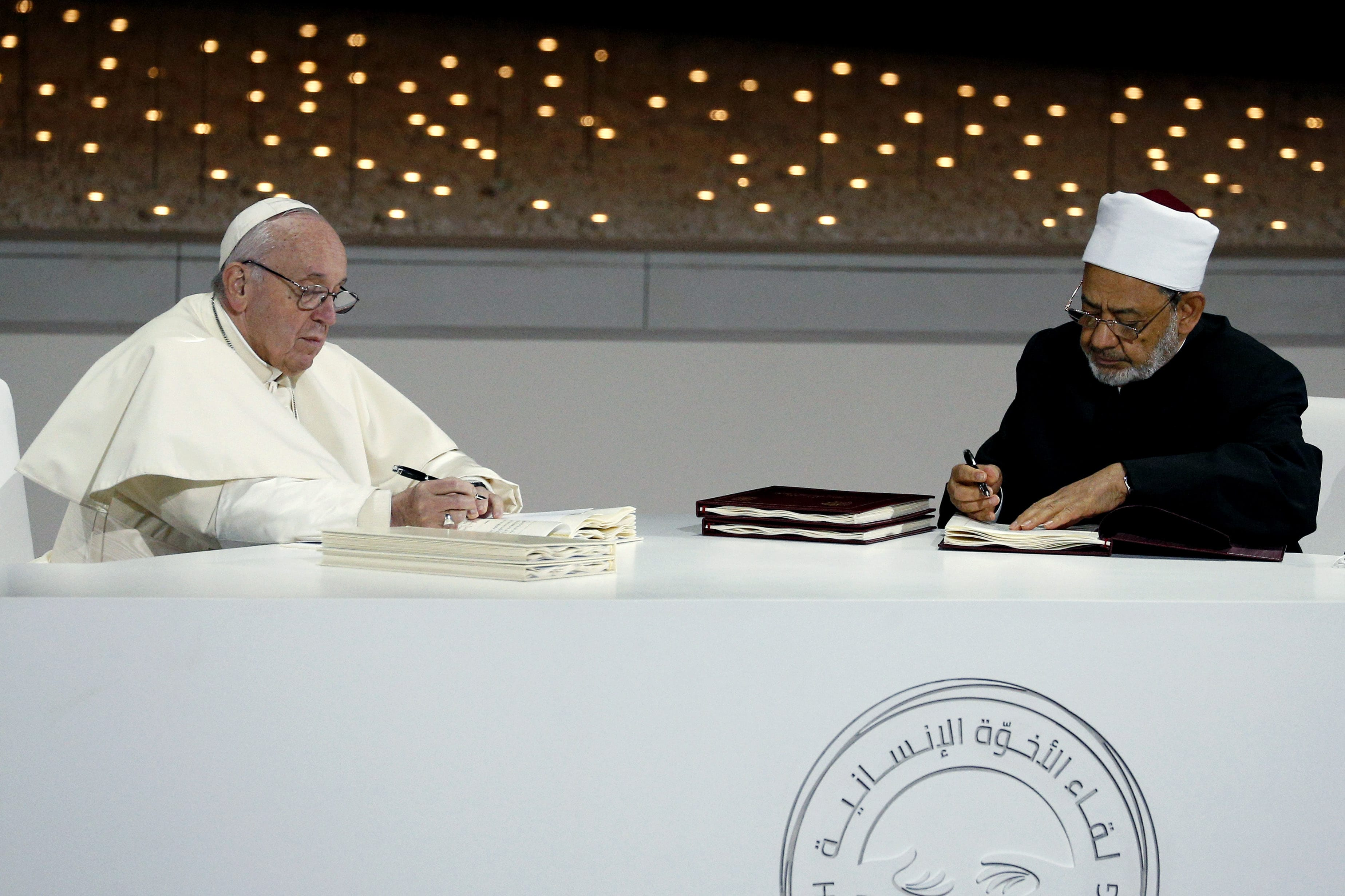 Pope Francis and Sheik Ahmad el-Tayeb, grand imam of Egypt's al-Azhar mosque and university, sign documents during an interreligious meeting at the Founder's Memorial in Abu Dhabi, United Arab Emirates on 4 February 2019. The Holy Father and Sheik el-Tayeb stepped into a theological debate on the will of God toward religions when they signed a document on