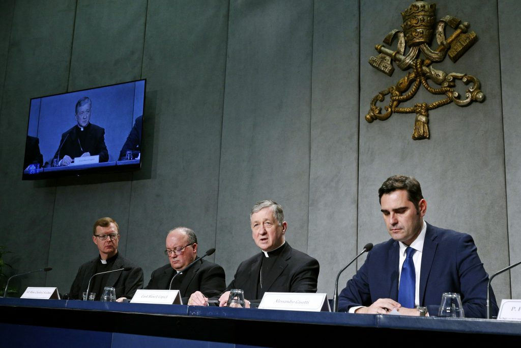 Jesuit Father Hans Zollner, Archbishop Charles J Scicluna of Malta and Cardinal Blase J Cupich of Chicago, all members of the organising committee for the 21 to 24 February Vatican meeting on the protection of minors in the Church, attend a press conference with Vatican spokesman Alessandro Gisotti to preview the meeting. Photo: Paul Haring/CNS.