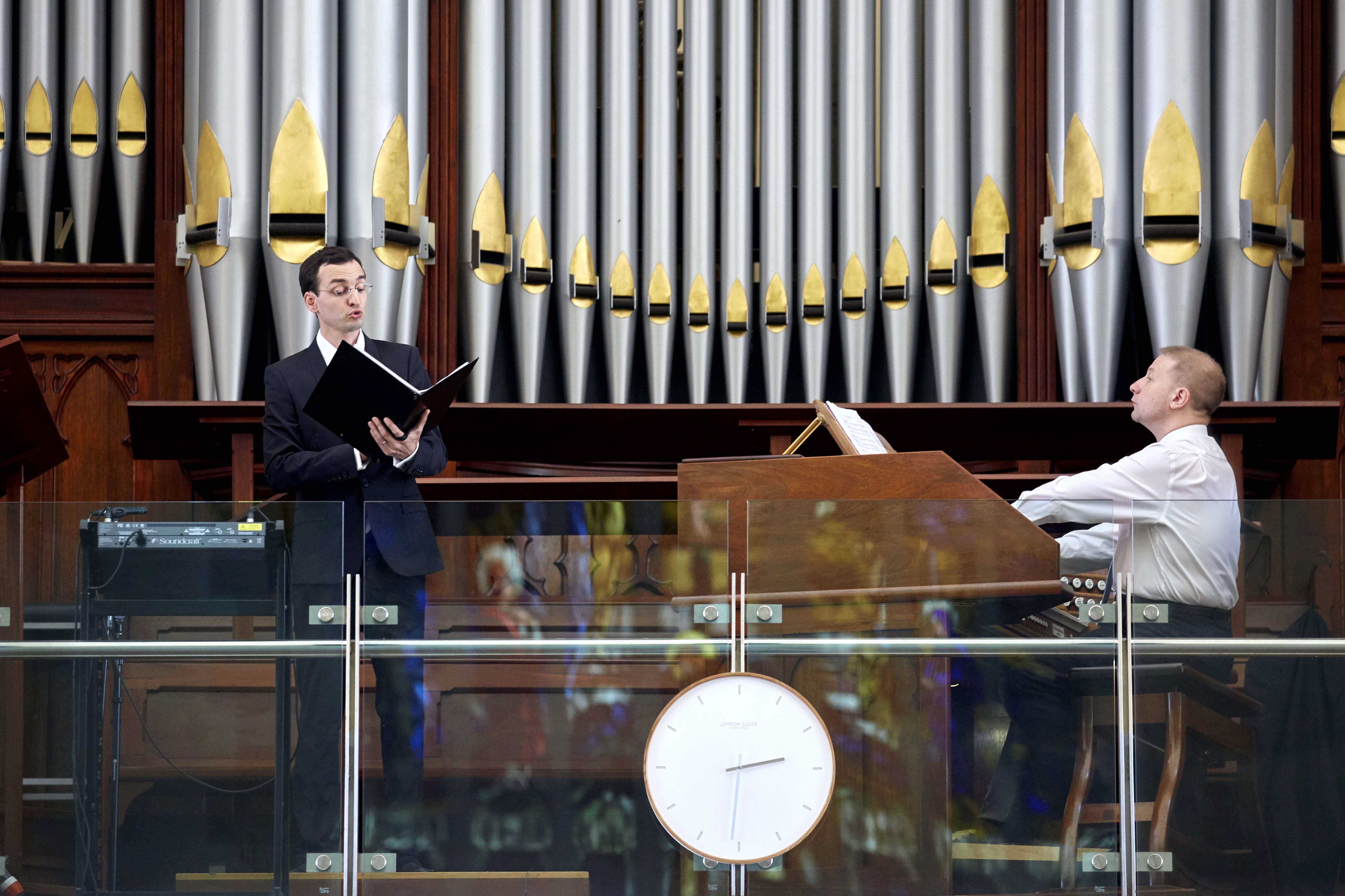 Paris Notre Dame Cathedral musicians, organist Johann Vexo and tenor vocalist Damien Rivieres performed at St Marys Cathedral on 10 February. Photo: Ron Tan.