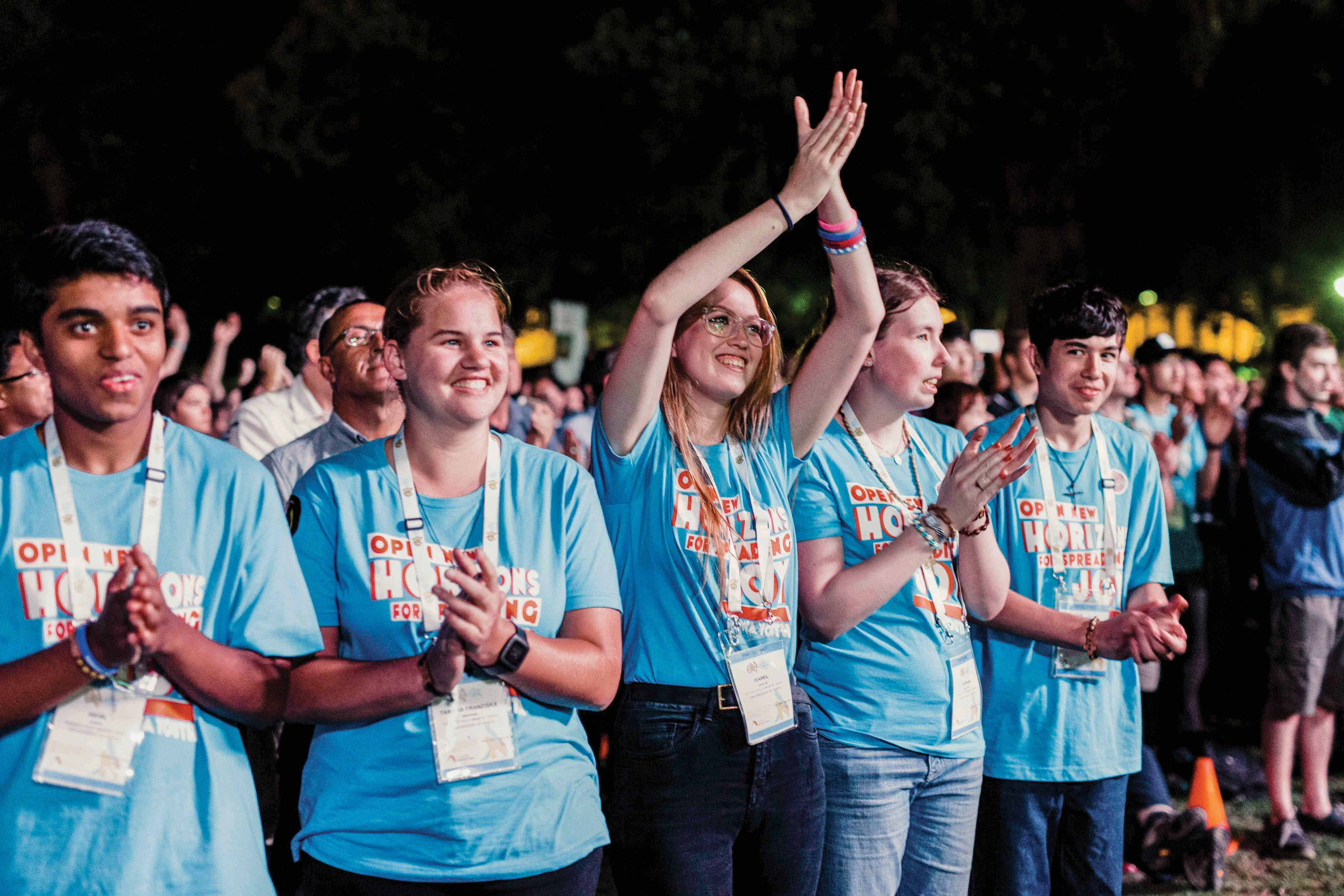 Youth react to the announcement of Perth as the host of ACYF for 2019 during the final Mass of ACYF 2017, held in Sydney. Photo: Cyron Sobrevinas.
