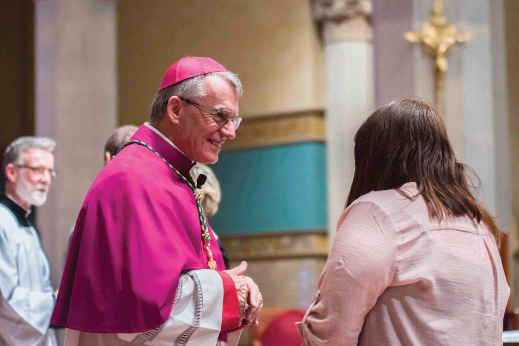 Archbishop Timothy Costelloe SDB listens to the experience of a young woman entering the Church in 2018. Photo: Ron Tan.