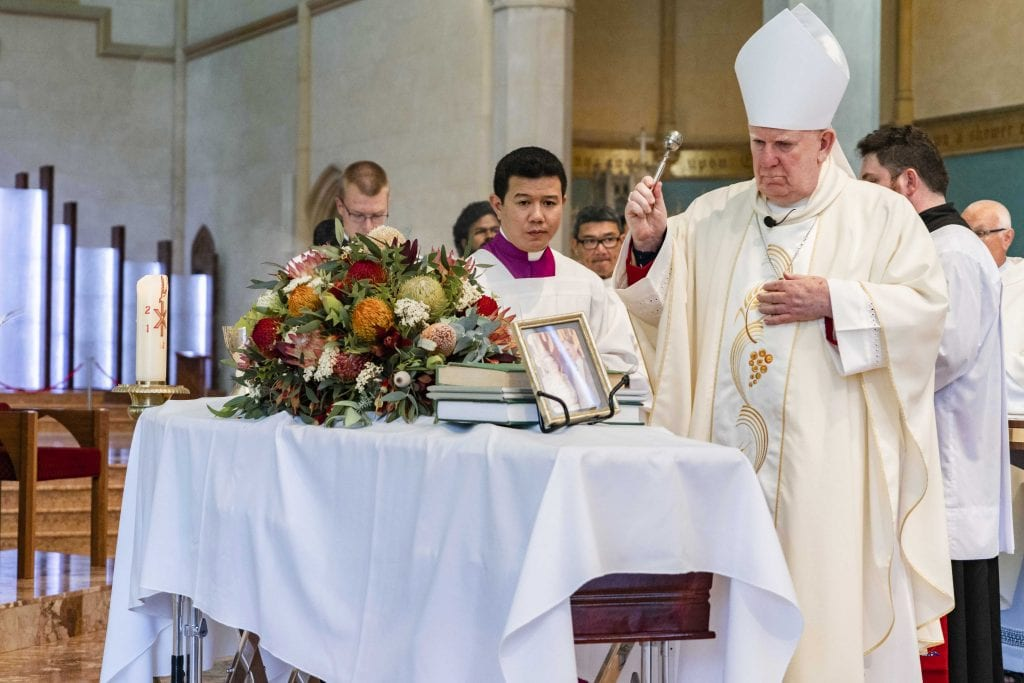 Bunbury Bishop Gerard Holohan blesses the coffin of Rev Dr Russell Hardiman during the Funeral Mass on Tuesday 29 January 2019 at St Mary's Cathedral. Photo: Jamie O'Brien.