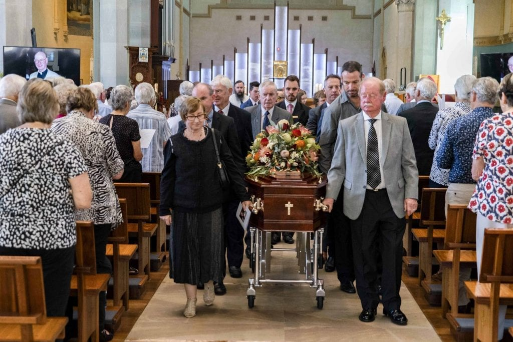 Family and friends of Rev Dr Russell Hardiman escort the coffin during the Funeral Mass on Tuesday 29 January 2019 at St Mary's Cathedral. Photo: Jamie O'Brien.