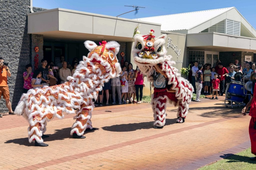 The Chinese Community Centre Lion Dance Troupe WA entertained those present for CNY with a traditional lion dance outside St Pius X Church. Photo: Matthew Lau.