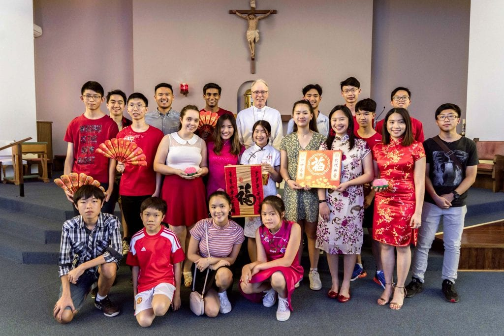 Auxiliary Bishop Donald Sproxton pictured after Mass with members of the SPX Youth Manning group. Photo: Matthew Lau.
