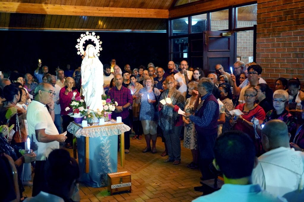 A candlelight procession with the statue of Our Lady took place after Mass on 11 February at Greenwood Parish. Photo: Matthew Lau.