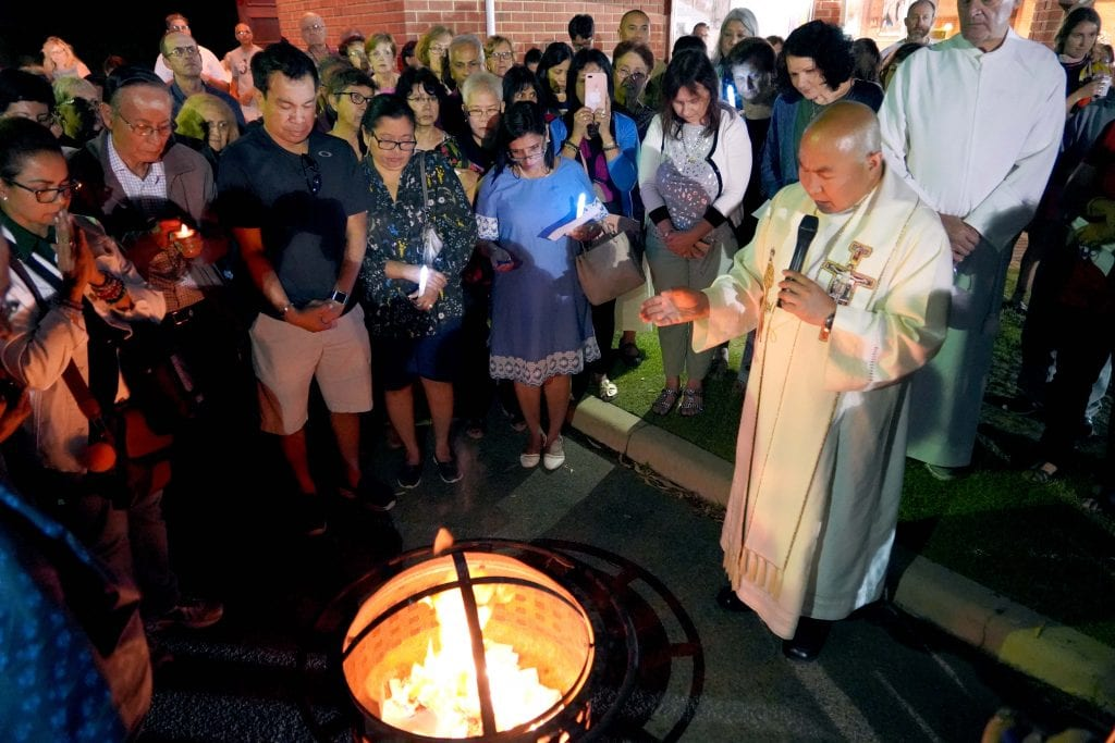 Greenwood Parish Priest Fr Elver Delicano burns the faithful's petitions to bring the 10-day novena to a finish. Photo: Matthew Lau.