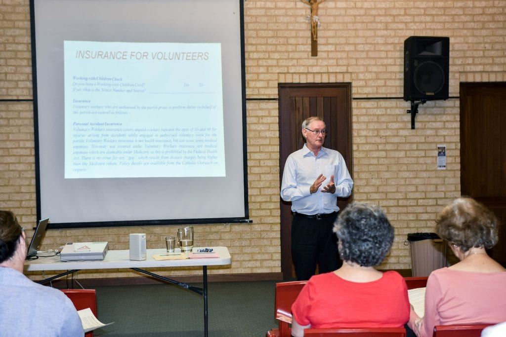Peter McMinn addresses an Ocean Reef Parish audience in 2017. Photo: The Record.