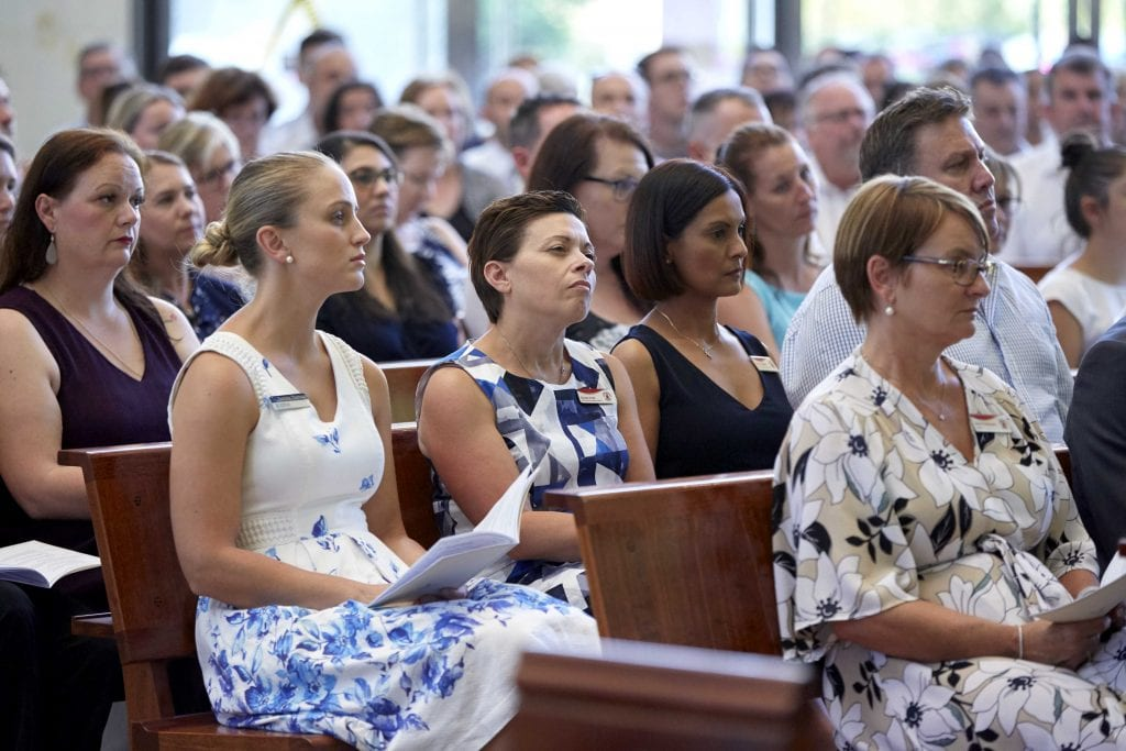 CEWA staff listen to Archbishop Costelloe's words of wisdom at St Mary's Cathedral on Friday 1 February. Photo: Ron Tan.