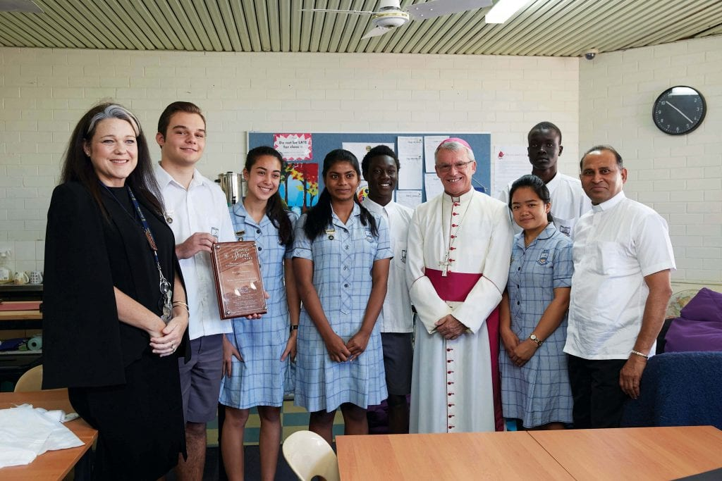 Archbishop Timothy Costelloe with Fr Albert Saminedi and Mercy College students and staff at the 2018 Lifelink Spirit Award. Photo: Ron Tan.