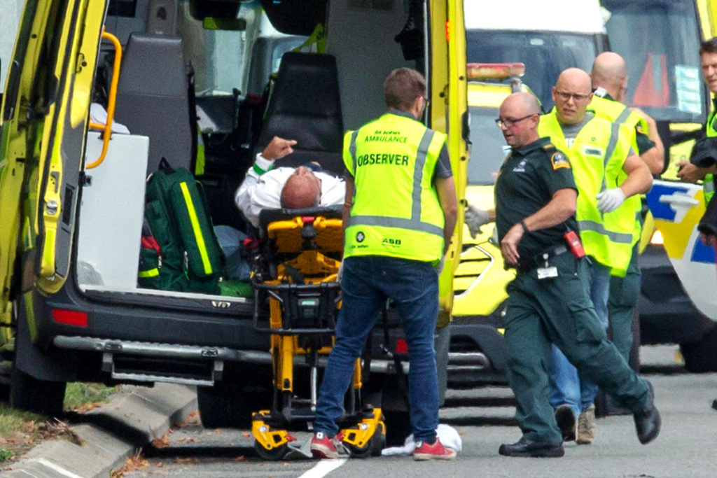 An injured man is loaded into an ambulance following a shooting at the Al Noor Mosque in Christchurch, New Zealand on 15 March 2019. New Zealand's Catholic bishops expressed their horror and distress at terrorist attacks on two mosques in Christchurch; at least 50 were people killed. Photo: CNS/Martin Hunter, Reuters.