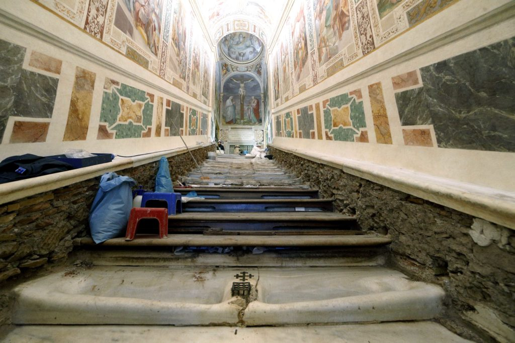 The Holy Stairs with concave indentations from years of wear from pilgrims are seen at the Pontifical Sanctuary of the Holy Stairs in Rome March 15, 2019. Vatican restorers have removed the wood covering the stairs, which tradition maintains Jesus climbed when Pilate brought him before the crowd. Pilgrims will have the opportunity to climb the bare marble stairs for at least a month after an April 11 unveiling of the renovated sanctuary. Photo: CNS/Paul Haring.