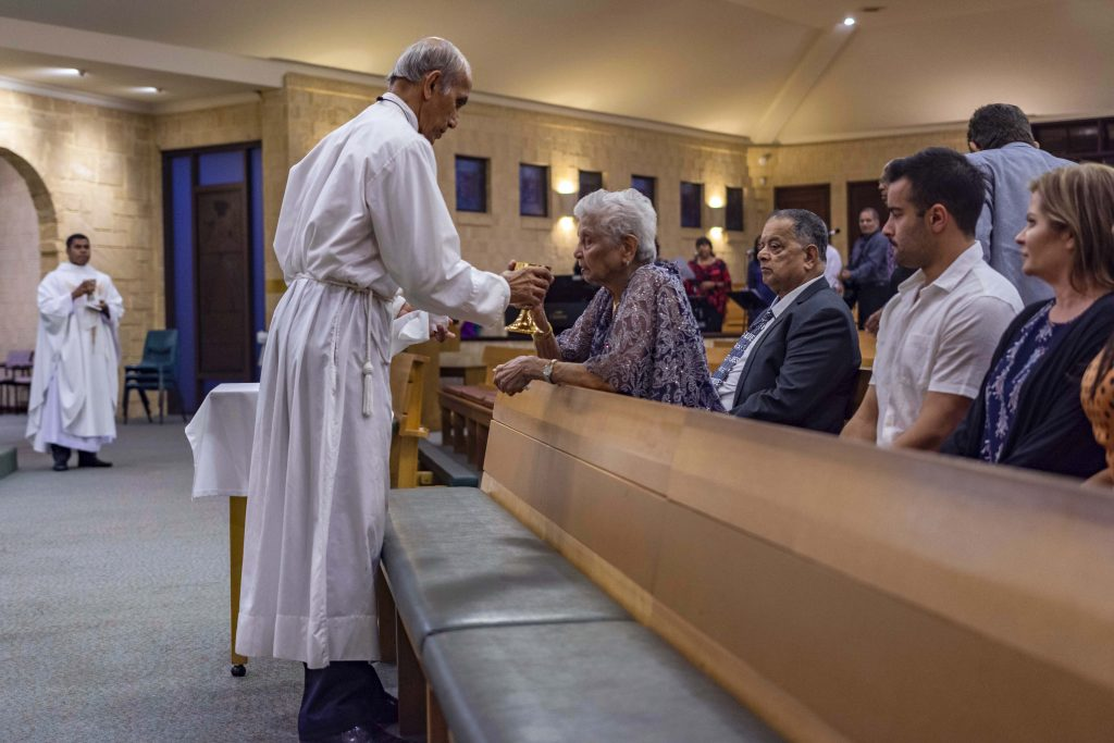 Devoted Lockridge parishioner Adriana Carvalho received the Blood of Christ. Photo: Eric Martin.